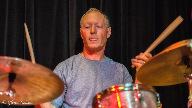Mark Ivester on drums.