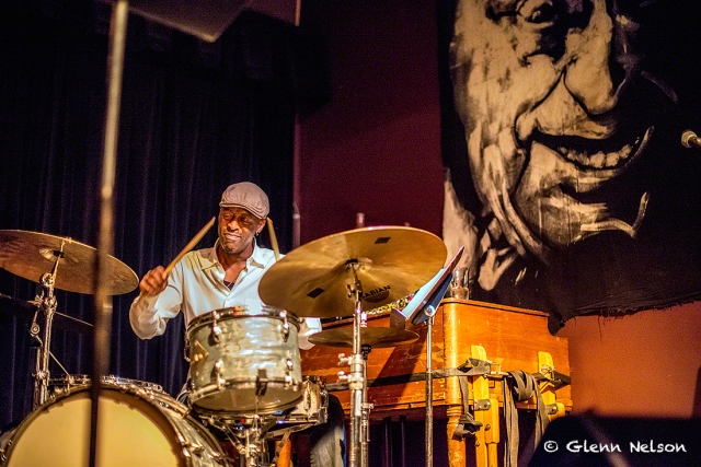 """Donald Edwards on drum, with an """"only-at-The-Royal-Room"""" backdrop."""