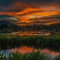 JUNE: A fiery sunrise at Sprague Lake in Rocky Mountain National Park.
