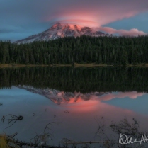 MARCH: Sunrise explodes above Mount Rainier, which looms over Reflection Lake.